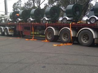 MA Series grain bunker fans being tied to semi trailer